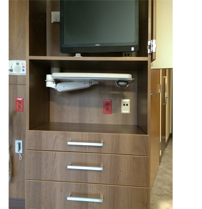 Centura Health undercabinet mounting solution shown in stowed position
