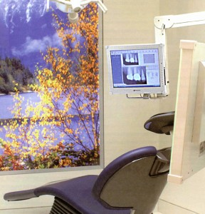 Wall mounted monitor in a dental operatory makes it easier to share images with the patient