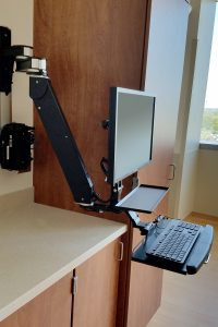 Titan Elite Wall Mount supports monitor and keyboard. Ideal for use in tight spaces.